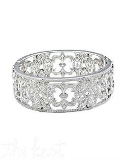 "18k white gold cuff bracelet features Fleur de Lis pave diamonds pattern. Diamond TW: 2.99; 6-1/2"" length; 1"" width. Rental jewelry."