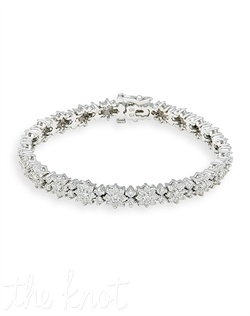 "14k white gold bracelet features round diamond clusters and eight- diamond flower patterns. Diamond TW: 5.00; 7"" length""; 1/4"" width. Rental jewelry."