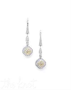 18k white and yellow gold earrings feature natural yellow diamonds surrounded by white diamonds. Diamonds TW: 1.11; 1-5/16&quot; length. Rental jewelry.