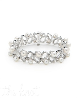 "18k white gold bracelet features pearls and diamond loops. Diamond TW: 1.89; 7"" length; 1/2"" width. Rental jewelry."