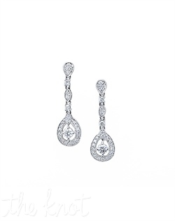 18k white gold drop earrings feature micro pave diamonds surrounding two round diamonds. Diamond TW: .84; 1-1/16&quot; length;  6/16&quot; width. Rental jewelry.