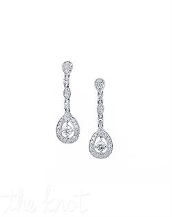 "18k white gold drop earrings feature micro pave diamonds surrounding two round diamonds. Diamond TW: .84; 1-1/16"" length;  6/16"" width. Rental jewelry."