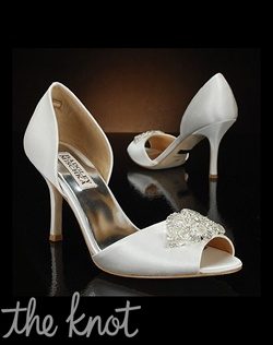 White or ivory satin D&#39;Orsay shoe features silver brooch. Other colors available.