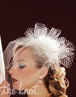 Bird cage veil features one tier and Russian Tulle. Swarovski Crystals optional. Available in White or Ivory.
