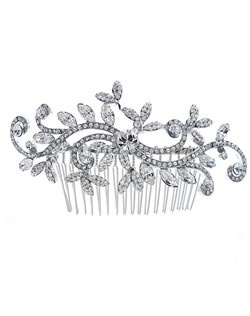 Comb features Austrian crystals in scroll and floral design.