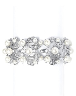 Bracelet features crystal vine design with white or ivory pearl accents.