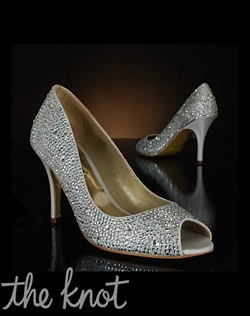 Silver peep-toe pump is covered in crystals. Also available in gold.