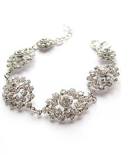 "Rhodium bracelet features Swarovski elements. Available in clear crystal or silver shade. 7"" L with 2"" extender."