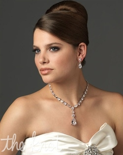 Silver-plated jewelry set (earrings and necklace) features cubic zirconias.