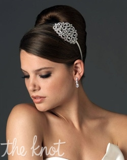 Silver-plated headband features Swarovski crystals.