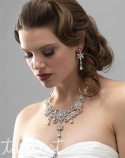 Silver-plated jewelry (necklace and earrings) set features rhinestones.