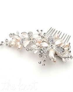 Silver-plated comb features rhinestones and freshwater pearls.