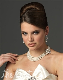Jewelry set (earrings and necklace) features pearls and rhinestones.