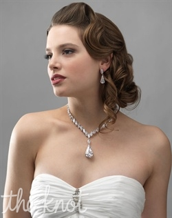 Jewelry set (earrings and necklace) features marquis-cut cubic zirconias.