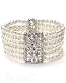 Rhodium-plated bracelet features 6 strands of pearls.