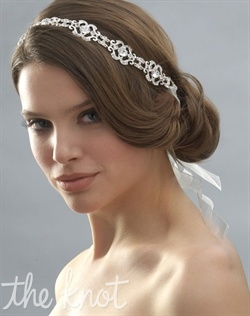 Ribbon headband features silver-plated rhinestones. Tulle ribbon available in white or ivory.