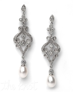 Sterling silver plated earrings feature cubic zirconia stones and freshwater pearls.