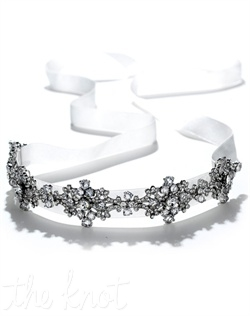 White or Ivory satin ribbon headband features silver rhodium-plated design encrusted with rhinestones.
