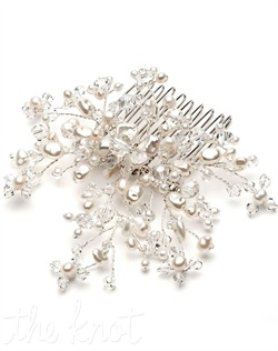 Silver-plated comb features freshwater pearls and Swarovski crystals.
