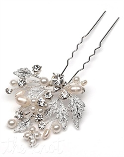 Hairpin features floral design with silver-plated leaves, freshwater pearls, and rhinestones.