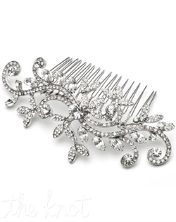Silver-plated comb features rhinestones and floral pattern.