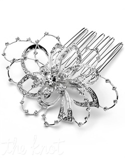 Silver-plated comb features rhinestones.