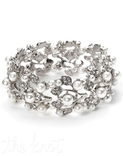 Silver-plated or gold bracelet features rhinestones and faux pearls.