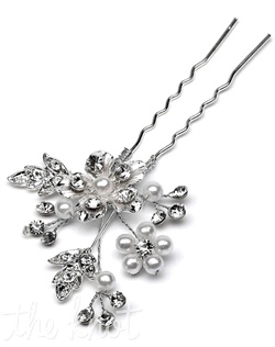 Silver hairpin features enamel flower, white faux pearls, and rhinestones.