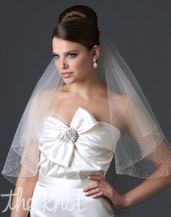Elbow-length two-tier veil features scattered Swarovski rhinestones, crystals, sequins, and pencil edge. White, ivory, or diamond white; finger-tip or cathedral-length also available