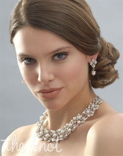 Sterling silver plated white or ivory necklace and earring set features faux pearls and rhinestones. Matching bracelet available.
