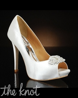 Peep-toe pump features rhinestone detail.