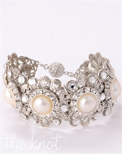 Cuff features freshwater pearls and Swarovski crystals.