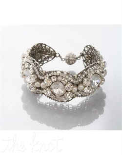 Cuff features Swarovski crystals, pearls and crystal clasp.
