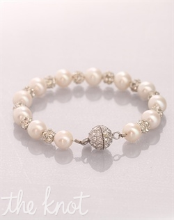 Bracelet features pearls, pava ball and Swarovski crystals.