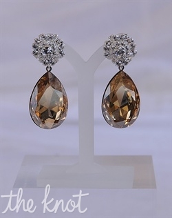 Earrings feature Swarovski crystals.
