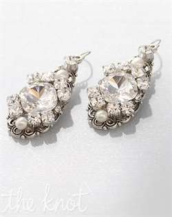 Earrings feature freshwater pearls, Swarovski crystals and filigree.