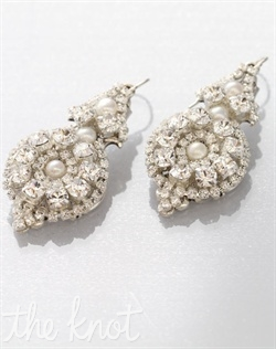 Earrings feature filigree, pearls and Swarovski crystals.