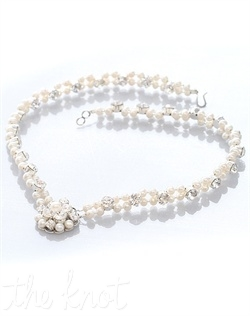 Necklace features freshwater pearls and Swarovski crystals.