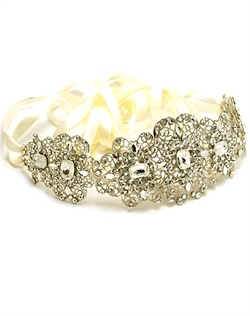 Rhodium-plated belt features Swarovski crystals, pearls and ribbon. Crystals and pearls available in various colors. Ribbon available in white, ivory, and light ivory. Custom sizing available.