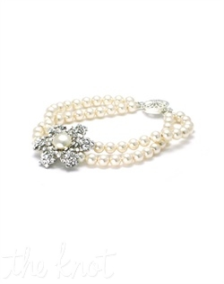 Double strand bracelet features Swarovski crystals, pearls, sterling silver lock and rhodium-plated flower. Various colors available. Custom sizing available.