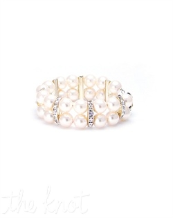 Double strand bracelet features Swarovski crystals, pearls, sterling silver lock and rhodium-plated flower. Various colors available.