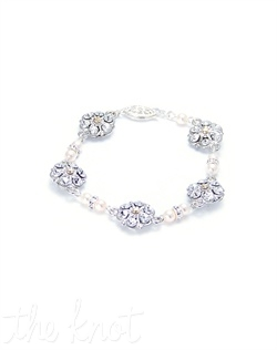 Rhodium-plated bracelet features filigree flowers, Swarovski crystals and pearls. Various colors available. Custom sizing available.