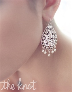 Rhodium plated earrings feature Swarovski crystals and pearls. Various colors available.
