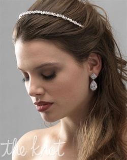 Silver-plated headband features Swarovski crystals and rhinestones.