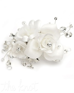 Comb features silk flowers, rhinestones and crystal beads.