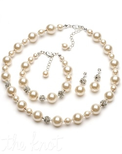 Jewelry set features glass pearls and rhinestone encrusted ball accents. Necklace, bracelet and earrings included. Various colors available.