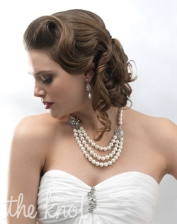Necklace features freshwater pearls, Swarovski rhinestones and crystals.
