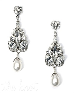 Rhodium-plated earrings feature Swarovski crystals, rhinestones and freshwater pearls.
