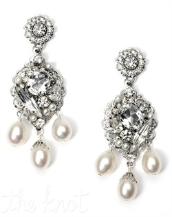 Rhodium-plated earrings feature freshwater pearls, Swarovski crystals and rhinestones.