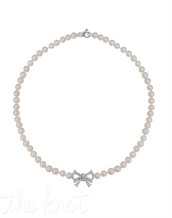 "From the Soft and Sophisticated Collection, this sterling silver necklace features over five dozen freshwater pearls, white topaz and bow detail. 18"" L"